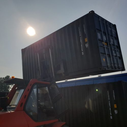 Container Stacking - Our onsite forklift double stacking 20ft containers.