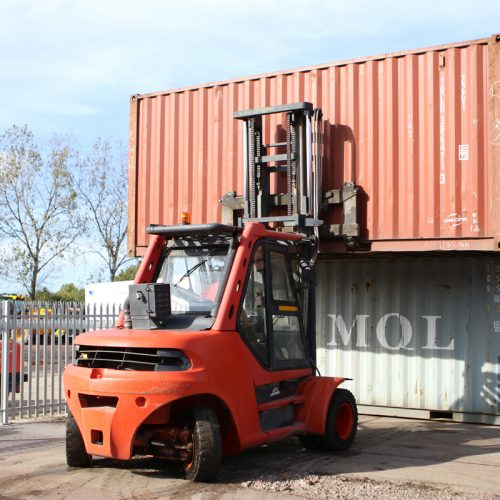 Stacking the containers - Double stacking 20ft used shipping containers on site.